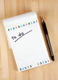 To do list. Notepad over table Royalty Free Stock Image