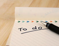 To do list. Notepad over table stock images