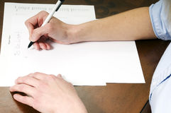 To Do List. A person writing a to do list in black ink Royalty Free Stock Photo