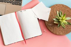 To do list on the background of laptop and potted plant. Working atmosphere. Notebook with space for text, sheets with pins on