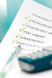 To Do List, ballpen and mobile phone, close-up. Miscellaneous German financial and tax terms Stock Image