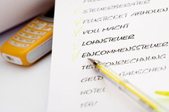 To Do List, ballpen and mobile phone, close-up. Miscellaneous German words Royalty Free Stock Images