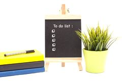 Book,pen and Mini chalkboard isolated over white. royalty free stock images