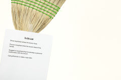 To Do List on Broom. Woman puts a To Do List on a broom Royalty Free Stock Photos