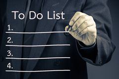 To Do List. Businessman writing To Do List procedure concept on screen Stock Photos