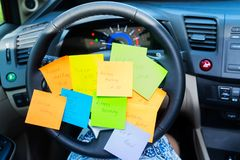 To do list in a car. On driving wheel - busy day concept Stock Images