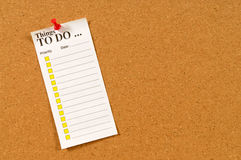To do list with checkboxes pinned to cork bulletin board. To Do List pinned to a cork bulletin board Royalty Free Stock Images