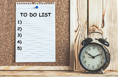 To Do List On Cork Board. With Alarm Clock On Wooden Shelf, Time Management Concept royalty free stock images
