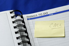 """""""To Do List"""" on the day planner. Isolated on blue Royalty Free Stock Images"""