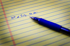 To Do List on Notebook Paper and Pen. Written to do list on notebook paper and pen Stock Photos