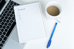 TO DO LIST. In office on laptop with coffee Royalty Free Stock Photo