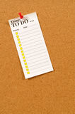 To do list pinned to cork bulletin board with checkboxes. To Do List pinned to a cork bulletin board Royalty Free Stock Images