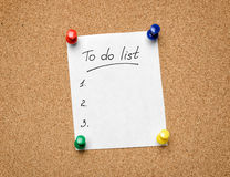A To Do List pinned to a cork notice board as an aid to efficien Stock Image