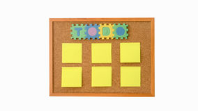 A To Do List with post it paper on cork notice board. It is an aid to efficiency and productivity. Empty post it for your text Royalty Free Stock Image