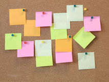 A To Do List with post it papers on cork notice board Stock Images