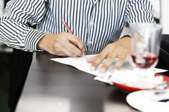 To do list or signing contract. Close up of hands signing the contract or at a seminar taking notes Stock Photography
