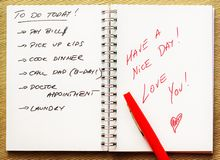 To-do list for a spouse. To do list for a spouse with a love message in red in a notebook royalty free stock photo