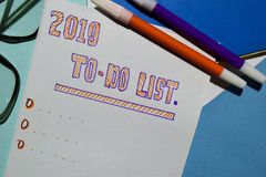 2019 TO DO LIST text with alarm clok, marker and eyeglasses for business presentation. Top view 2019 TO DO LIST text with alarm clok, marker and eyeglasses for vector illustration