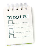 To do list on white notebook. To do list on white paper notebook Royalty Free Stock Photos
