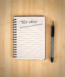 To do list. On the wooden table Royalty Free Stock Photography
