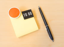 To do List Yellow Postit with Smile Icon and Black Pen on Wood T Stock Photography