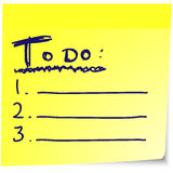 To do list on yellow sticky note paper. Todo list on yellow sticky note paper with handwritten text Stock Photo