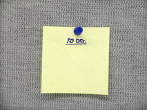 To Do Note. Office to do note on a cubical wall Stock Image