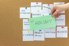 To-do tasks with inscription Holiday in the foreground Royalty Free Stock Images