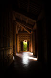 To the door. Wooden hallway and a door at the end Stock Photography