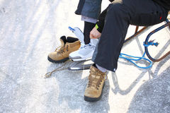 To dress skate ice skating outdoors winter Stock Photo