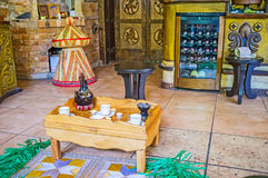 To drink coffee like Ethiopians. Ethiopian coffee ceremony: coffee is brewed three times awel, kalei, baraka, host of ceremony is only a woman, coffee is pouring Royalty Free Stock Photo