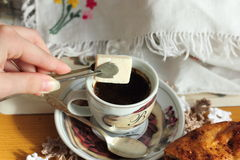 To drink coffee with sugar Royalty Free Stock Photos