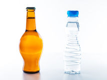 To drink water is healthier than drinking beer Royalty Free Stock Photography