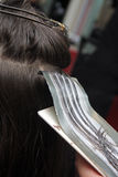 To dye hair. Hairdresser is dyeing long hair Royalty Free Stock Images