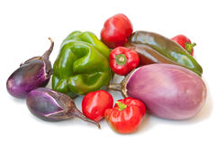 To eat healthy: vegetables. Peppers and eggplants are some of the foods of the Mediterranean diet Royalty Free Stock Photos