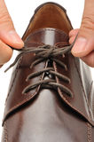To fasten bootlace on shoes Royalty Free Stock Images
