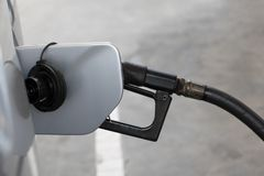 To fill the car with fuel, close up. stock image