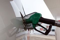 To fill the car with fuel. The pump gas station stock photography