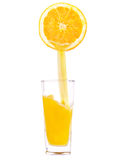 To fill, pour a glass of juice, orange. Orange juice is poured into a glass of orange Stock Photos