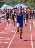 To the Finish Line. A sprinter makes a final effort during a track meet in Redding, California Stock Photos