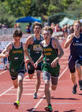 To the Finish Line. A sprinter makes a final effort during a track meet in Redding, California Royalty Free Stock Photography