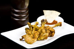 To fry chicken wings, on a black background Royalty Free Stock Images
