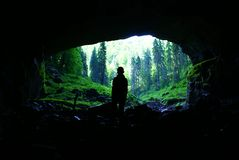 To the future, to the light !. Cave portal Coiba Mare, near Village Casa de Piatra ,whose size is 47 meters high and 74 meters breadth,in the National Park of Royalty Free Stock Photo