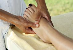 To the girl do massage. Of legs Royalty Free Stock Photography