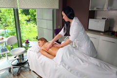 To the girl do massage in the beauty salon Stock Photo