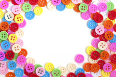 tło guziki barwią wielo- biel Fotografia Stock