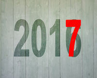 2016 to 2017, happy new year concept. On old wooden wall background Royalty Free Stock Images