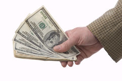 To have money to burn. Money makes money. The man holds a fan of money in a hand stock photography