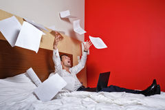 To hell with the job. Businessman throws documents. royalty free stock photography
