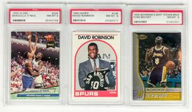 Graded Basketball Cards. To increase value basketball cards are graded to determine their condition and overall value royalty free stock image